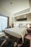 Interno della camera da letto o della camera di albergo Immagini Stock