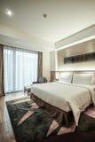 Interno della camera da letto o della camera di albergo Immagine Stock