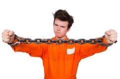 Interno joven con las cadenas imagen de archivo libre de regalías