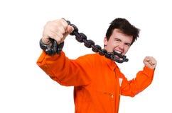 Interno joven con las cadenas aisladas Foto de archivo libre de regalías