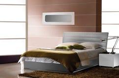 Interno per una camera da letto, un letto Fotografia Stock