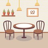 Interno piano del deposito del forno con la tavola coperta di panno bianco, di due sedie di legno, di piante in vaso e di immagin royalty illustrazione gratis
