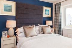 Interno splendido della camera da letto della casa di manifestazione Fotografia Stock