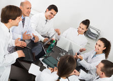 Interns and professor at hospital meeting Royalty Free Stock Photos