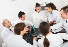 Interns and professor at hospital meeting Royalty Free Stock Photography