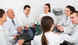 Interns and professor at hospital meeting Royalty Free Stock Image