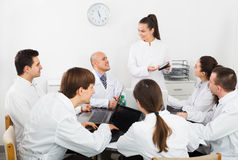 Interns and professor at hospital meeting royalty free stock photo