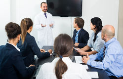 Interns and professor at meeting stock photos