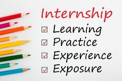 Internship Checklist Concept. Internship and colored pencils with keywords written on white background royalty free stock images
