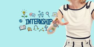 Internship concept with young woman. On a blue backgroundn royalty free stock image