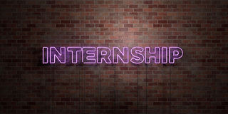 INTERNSHIP - fluorescent Neon tube Sign on brickwork - Front view - 3D rendered royalty free stock picture Stock Photography
