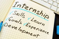 Internship and list of pros written in the note. Internship and list of pros written in the notepad royalty free stock photos