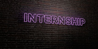 INTERNSHIP -Realistic Neon Sign on Brick Wall background - 3D rendered royalty free stock image Royalty Free Stock Photos