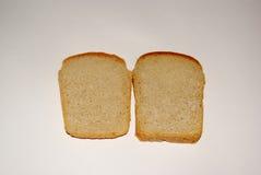 Intero pane del grano su fondo grigio Immagini Stock