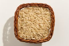 Intero seme cinese del riso Vista superiore dei grani in un canestro fine Immagine Stock Libera da Diritti