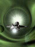 Interplanetary Spaceship Approaching Light Speed. Science fiction illustration of an interplanetary spaceship approaching light speed entering a green wormhole Stock Photo
