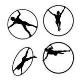 Interprète de cirque d'acrobate de silhouette de Cyr Wheel Image libre de droits