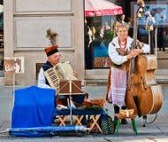Interprètes de rue à Cracovie, Pologne Photographie stock libre de droits
