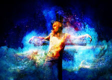 Interpretation of Jesus on the cross in cosmic space. Royalty Free Stock Images