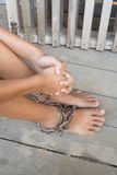 Interpreter. Child was gets foot interpreter by the chains Stock Images