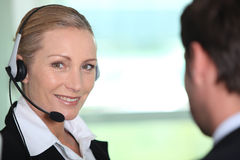 Interpreter smiling. At one of her colleagues Royalty Free Stock Photography