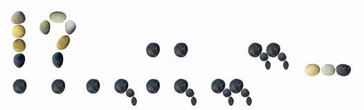 Interpunktionszeichen gemacht von den Kieseln Lizenzfreie Stockfotos