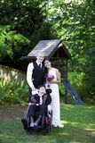 Interracial bride and groom standing with her disabled little bo Stock Photography