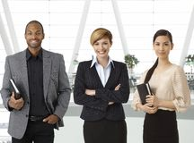 Interracial business team in business hallway stock photography