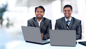Interracial business team working at laptop Stock Images
