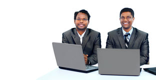 Interracial business team working at laptop Stock Photos