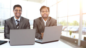 Interracial business team working at laptop in modern office Stock Photo