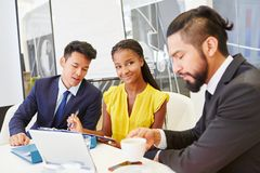 Interracial business team working togehter stock photos