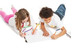 Interracial  children drawing together Royalty Free Stock Photos