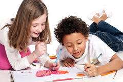 Interracial  children drawing together Stock Images