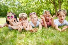 Interracial children having fun. At park during summer vacation stock photo