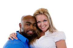 Interracial Couple. An interracial couple smile at the camera royalty free stock photography