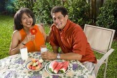 Interracial couple in backyard Stock Photo