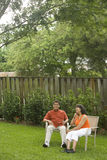 Interracial couple in backyard Royalty Free Stock Image