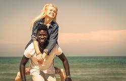 Interracial couple. On the beach stock photo