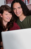 Interracial couple with copy space on laptop Stock Photography
