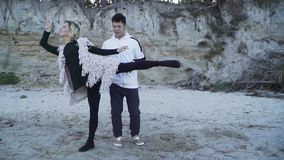 Interracial couple dancing in free style outdoors. Asian guy and caucasian girl dancing contemporary dance. Teenagers in stock footage