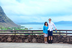 Interracial couple in forties by railing in Hawaii Stock Photography