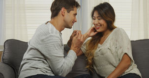 Interracial couple gets engaged! Stock Photography
