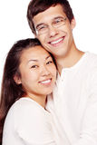 Interracial couple in love. Close up portrait of young interracial couple, hispanic men and asian girl, hugging and smiling attractive healthy toothy smile Stock Photography