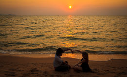 Interracial Couple loving watching sunset Stock Images