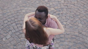 Interracial couple meets and hugs stock footage