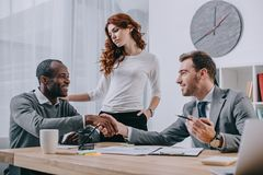 Interracial couple in office of royalty free stock photography
