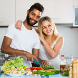 Interracial couple preparing healthy dinner Stock Image