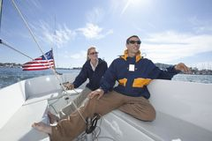 Interracial Couple Sailing Stock Photography
