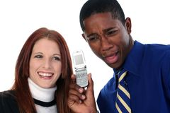 Interracial Couple Sharing Cellphone Stock Photography